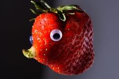 Jordgubbe med den naturliga fullvuxna näsan som en framsida Royaltyfria Foton