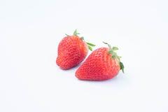 Jordgubbe på vit bakgrundsfruit& x27; healthful fruktjuice för s som är användbar fotografering för bildbyråer