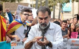 Jordi Cuixart during demostration for independence in Barcelona. Jordi Cuixart leader of Omnium cultural association, actually in jail, gestures during a massive Stock Photos