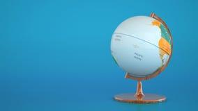 Jordklot med den geografiska översikten på blå bakgrund Arkivfoton