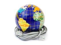 Jordklot och kabel royaltyfri foto