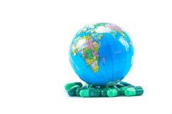 Jordklot och medicin Arkivbild
