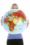 jordklotholdingkvinna Arkivfoto