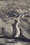 Jordlagerhögar i en kolgruva Arkivbilder