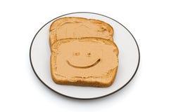 Jordnötsmör och hel veterostat bröd Arkivfoto