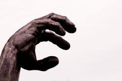 Jordning för skulpturhand arkivfoton