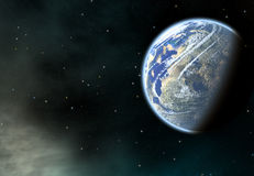Jordplanet med en sidoskugga på kosmosstjärnabakgrunder Arkivbild