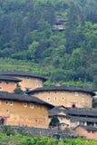 Jordslotten lokaliserar i berg i Fujian, söder av Kina Arkivbild