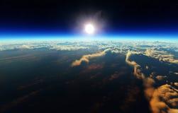 Jordsoluppgång från yttre rymd Arkivbild