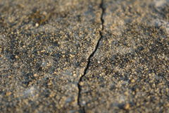 Jordsten knäckt bakgrundsbruk Arkivbild