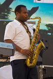 Jorga Mesfin plays saxophone Royalty Free Stock Images
