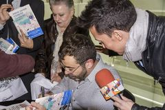 Jorge Javier Vazquez. BADALONA, SPAIN - DECEMBER 01: Jorge Javier Vazquez, his mother The Mari and reporter Omar Suarez, signing books and interviewed during the Stock Image