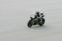 Jorge Lorenzo accelerates at sepang, malaysia Royalty Free Stock Image