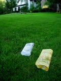 Jornais no gramado Foto de Stock Royalty Free