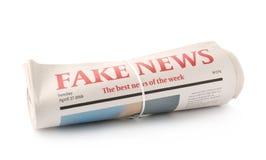 Jornais rolados no fundo branco foto de stock