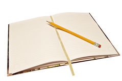 Jornal com lápis Fotografia de Stock