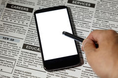 Jornal e smartphone falsificados Imagem de Stock