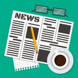 Jornal e uma chávena de café Fotos de Stock