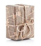 Jornal empacotado caixa com curva da corda fotografia de stock royalty free