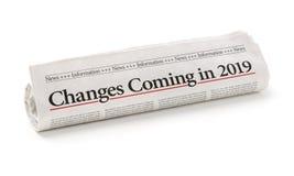 Jornal rolado com as mudanças do título que vêm em 2019 foto de stock royalty free