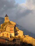 Josa del Cadi. The little pyrenean village of Josa del Cadi at dusk with fog in background Royalty Free Stock Photography