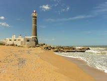Jose Ignacio Lighthouse och stranden royaltyfria foton