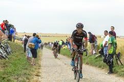 Jose Joao Mendes Pimenta Costa Riding sur une route de pavé rond - à Images stock