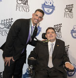 Jose Posada and Marc Buoniconti. Former MLB All-Star catcher with the NY Yankees, Jose Posada, an honoree, arrives on the red carpet to join Marc Buoniconti for Royalty Free Stock Image