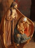 Joseph, Mary and baby Jesus made from a single piece of wood. Joseph, Mary and baby Jesus made from a single piece of hand decorated wood Royalty Free Stock Images