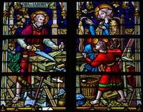 Joseph, Mary och Jesus - målat glass i den Mechelen domkyrkan Arkivfoto
