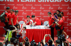 Joseph Schooling, the Singapore's first Olympic gold medalist, signing autographs at Raffles City, as part of his victory par. Joseph Schooling signing stock photography