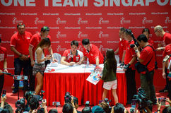 Joseph Schooling, the Singapore's first Olympic gold medalist, signing autographs at Raffles City, as part of his victory par. Joseph Schooling signing stock images