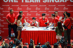 Joseph Schooling, the Singapore's first Olympic gold medalist, signing autographs at Raffles City, as part of his victory par. Joseph Schooling signing royalty free stock image