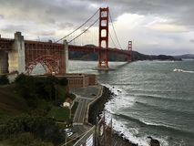 As a Red and White ferry passes under the famous  Golden Gate Bridge, the hidden second bridge is visible. When Joseph Strauss completed the Golden Gate Bridge Stock Photo