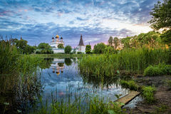 Joseph-Volokolamsk Monastery reflecting in pond. On sunset, Moscow oblast, Russia Royalty Free Stock Photos