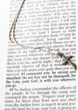 Joshua 1:9. Bible scripture with a cross necklace Stock Photography