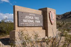 Joshua Tree, California - Sign for the Joshua Tree National Park entrance at the north end of the park. Sign for the Joshua Tree National Park entrance at the royalty free stock photography