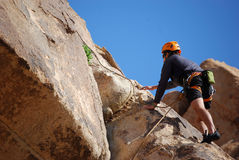 Joshua Tree Multi-Pitch. A climber, second in line follows on the first pitch of a traditional route climb in Joshua Tree National Park, California Stock Image