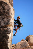 Joshua Tree Multi-Pitch. A climber, second in line follows on the first pitch of a traditional route climb in Joshua Tree National Park, California Royalty Free Stock Images