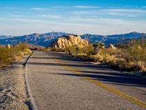 Joshua Tree National Park. Highway in the late afternoon light. Joshua Tree National Park, California royalty free stock image