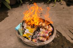Joss paper burn in fire in Chinese Ghost Festival royalty free stock photography