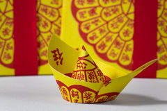Joss Paper Chinese Tradition for passed away ancestor`s spirits.  Royalty Free Stock Image