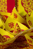 Joss Paper Chinese Tradition for passed away ancestor`s spirits.  Stock Photo