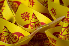 Joss Paper Chinese Tradition for passed away ancestor`s spirits.  Stock Image