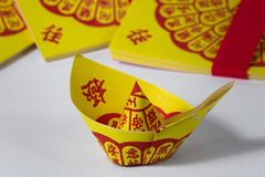 Joss Paper Chinese Tradition for passed away ancestor`s spirits.  Royalty Free Stock Images