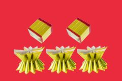 Joss Paper Gold Bullion For Chinese New Year Tradition. On red background Royalty Free Stock Photography