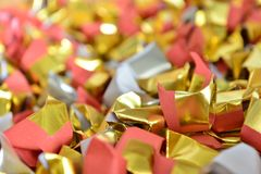 Joss paper gold and silver paper for worship with Joss Paper Chinese Tradition. Gold Paper folded for passed away ancestor`s. Spirits for chinese ceremony royalty free stock photos
