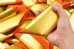 Joss-Papier an Hand Lizenzfreies Stockbild