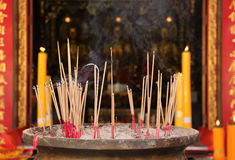 Joss stick burning at china temple. Joss stick and yellow candle burning at china temple Stock Image