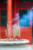 Joss stick burning in incense furnace at a temple Stock Images